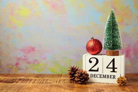 Christmas calendar with pine tree on wooden table Stock Photo