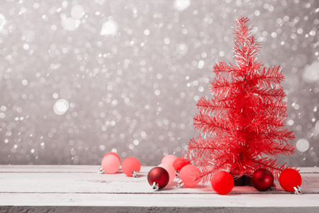 christmas red: Red christmas tree with decorations on wooden table