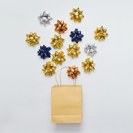 Christmas shopping bag with bows and stars on white background. Flat lay. 스톡 콘텐츠