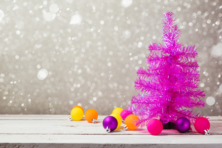 pink christmas: Pink christmas tree with decorations on wooden table Stock Photo