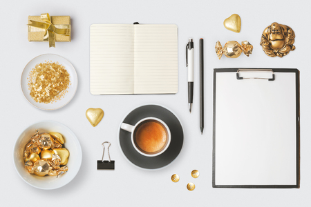 notebook design: Modern objects and items for mock up template design. Notebook, coffee cup and chocolate. View from above. Flat lay