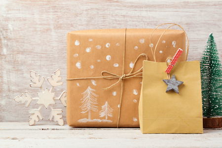 christmas backdrop: Christmas background with homemade gift bag, box and rustic decorations Stock Photo