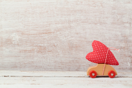 concept car: Valentines day concept with toy car and heart shape Stock Photo