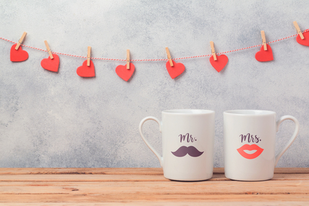 Valentines day romantic dating concept with couple of coffee cups.