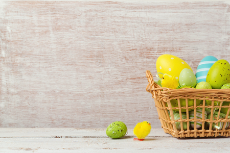 backdrops: Easter holiday background with decorations eggs in basket
