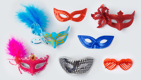 mardigras: Carnival or mardi gras masks on white background for mock up template design. View from above. Flat lay Stock Photo