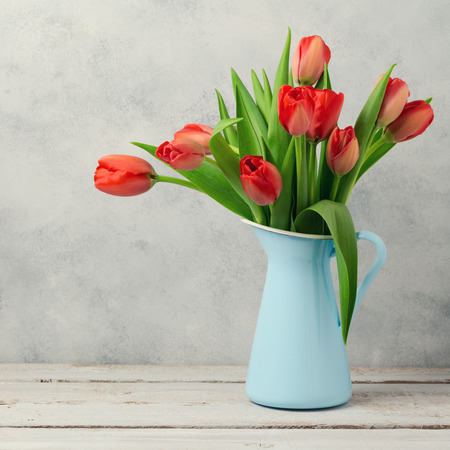 red tulip: Red tulip flowers bouquet over rustic background