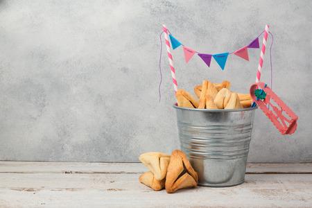 hamantaschen: Hamantaschen cookies or hamans ears in bucket  over rustic background for Jewish holiday Purim concept