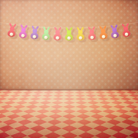 holiday garland: Vintage interior background with checked floor,  pink polka dots wallpaper and bunny garland. Easter holiday concept Stock Photo