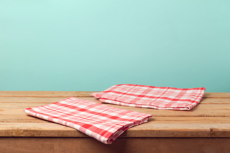aqua background: Empty wooden deck table with tablecloth over mint background for product montage display Stock Photo