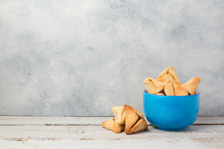 haman: Purim celebration concept with hamantaschen cookies on wooden table