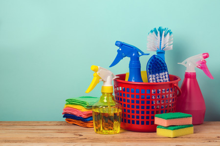 office tool: Spring cleaning concept with supplles over mint background Stock Photo