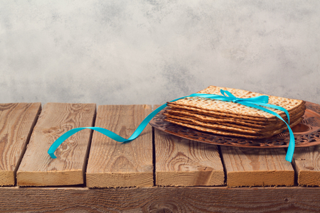 matzoh: Passover holiday background with matzoh on wooden table Stock Photo