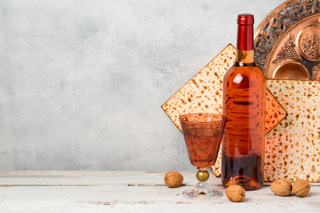 Passover holiday concept with wine and matzoh over rustic background Standard-Bild
