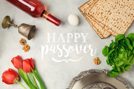 matzah: Jewish holiday Passover Pesah greeting card with seder plate, matzoh and wine bottle. Stock Photo