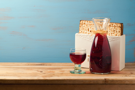Jewish holiday passover concept with wine and matzoh over wooden blue background with copy space Stock Photo