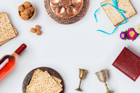 matzoh: Jewish holiday Passover background with wine, matza and seder plate. View from above. Flat lay Stock Photo