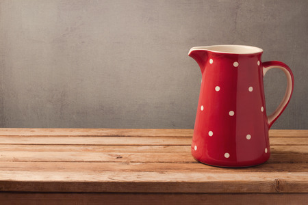 background settings: Retro jug on wooden table. Kitchen background with copy space Stock Photo