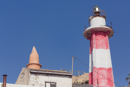 jaffo: Lighthouse in Jaffo over sky background with copy space