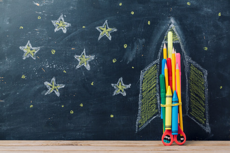 Back to school concept with rocket made from pencils over chalkboard background 免版税图像 - 82169216