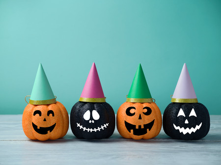 Halloween glitter pumpkin jack o lantern decor with party hats.