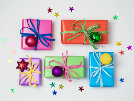 christmas backdrop: Christmas colorful gift boxes on white background. Christmas sale concept. View from above. Flat lay Stock Photo