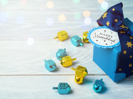 Hanukkah celebration with gift box and spinning top Stock fotó