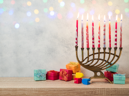 Jewish holiday Hanukkah background with menorah and gift boxes