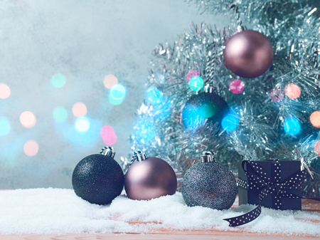 Christmas tree background with bauble decorations in black and silver colors