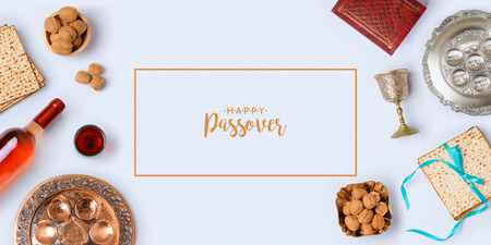 Jewish holiday Passover banner design with wine, matzo and seder plate on white background. View from above. Flat lay.Translation for Hebrew Text: Passover, horseradish, celery, egg, bone, bitter herb, charoset - paste made of fruits Stock Photo