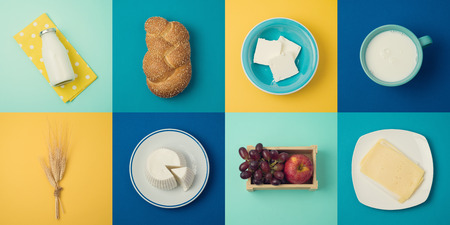 Jewish holiday Shavuot concept with milk and dairy products. View from above. Flat lay Stock Photo