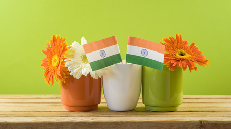 India Independence day background with indian flag, chalkboard and flowers.