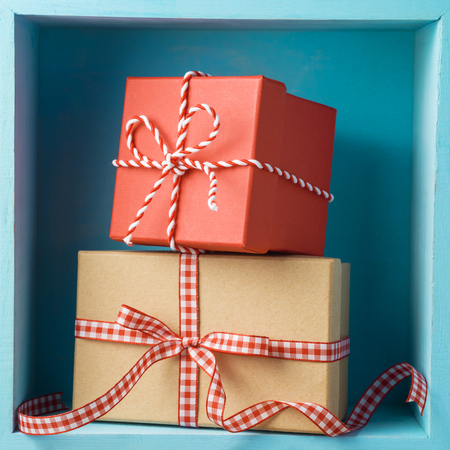Christmas holiday composition with gift boxes on wooden shelf