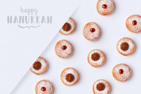 Jewish holiday Hanukkah sufganiyot on white background. Top view from above Stok Fotoğraf
