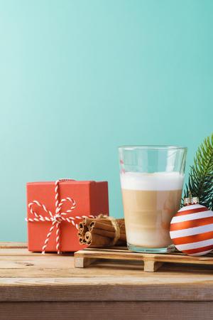 Hot Latte macchiato coffee cop  on wooden table. Christmas menu concept