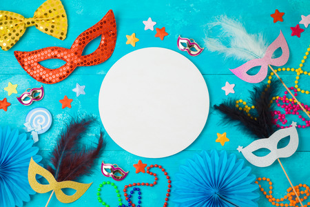 Carnival or mardi gras background with carnival masks, beards and photo booth props. Top view from above Stock Photo