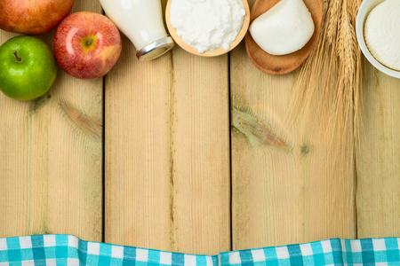 Milk and cheese, dairy products on wooden table background. Jewish holiday Shavuot concept. Top view from above 写真素材