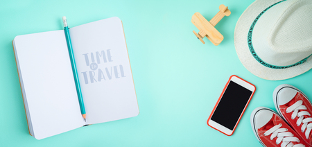 Travel and tourism concept with traveling accessories on blue background. Top view from above