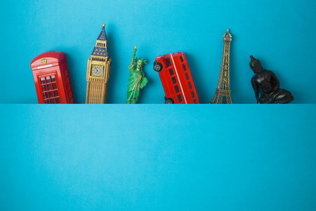 Travel and tourism concept with souvenirs from around the world on blue  background. Top view from above 写真素材