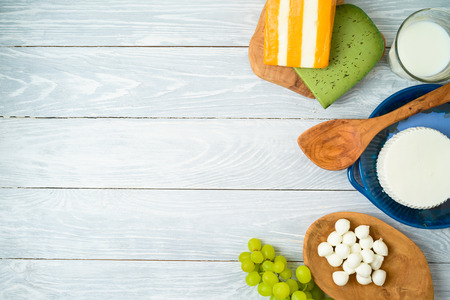 Milk and dairy products on wooden background. Top view from above