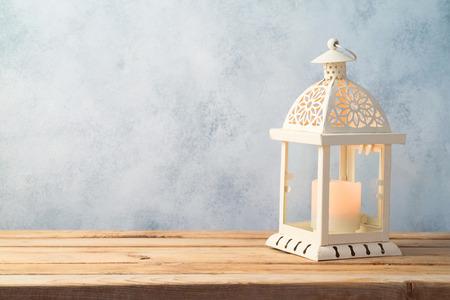 Lightened lantern on wooden table over rustic background. Islamic holiday celebration concept Reklamní fotografie