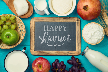 Milk and cheese, dairy products and fruits on wooden table background. Jewish holiday Shavuot concept. Top view from above 写真素材