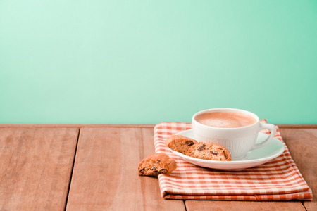 Coffee cup with italian biskotti cookies on wooden table  background