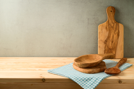 Kitchen olive wood utensils on wooden table. Cookng concept background