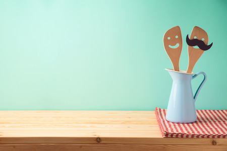 Kitchen cute utensils in blue jug on wooden table. Cookng and baking concept background 写真素材