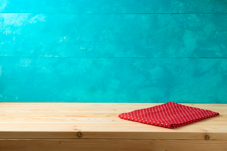 Empty wooden table with tablecloth over blue rustic  background