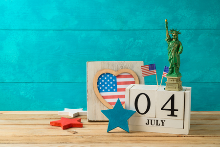 Happy Independence Day, 4th of July celebration concept with calendar and american flag on wooden table