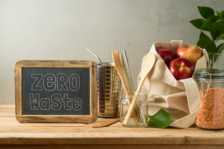 Zero waste lifestyle concept with cotton bag and glass jars on wooden table