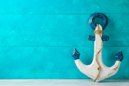 Summer vacation background with anchor decor on wooden table