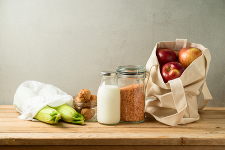 Zero waste lifestyle and shopping concept with cotton bag and glass jars on wooden table